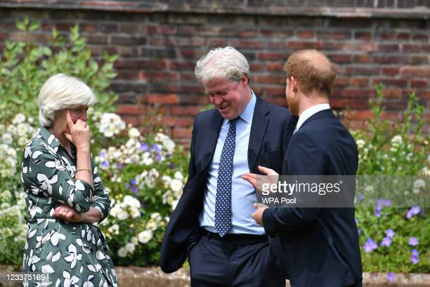 Prince Harry, Duke of Sussex with his aunt Lady Jane Fellowes and uncle Earl Spencer during the unveiling of a statue of Diana, Princess of Wales, in...
