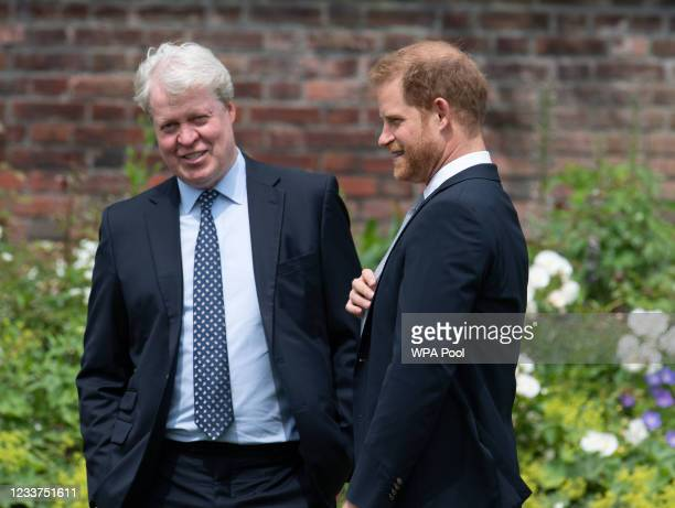 Prince Harry, Duke of Sussex with his uncle Earl Spencer during the unveiling of a statue of Diana, Princess of Wales, in the Sunken Garden at...