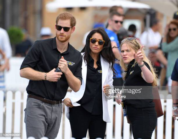 Prince Harry Duke of Sussex with Meghan Duchess of Sussex and her assistant Amy Pickerill attend the Invictus Games Sydney 2018 Jaguar Land Rover...