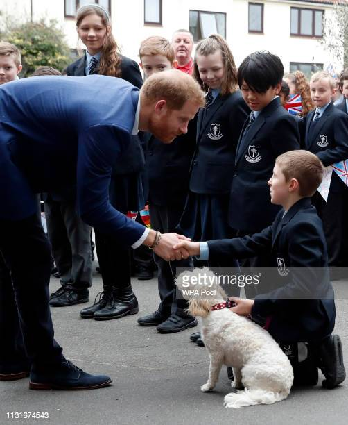 Prince Harry Duke of Sussexgreets pupils from St Vincent's Catholic Primary School along with the head teachers dog called Winnie before going on to...
