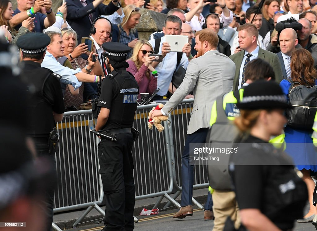 Prince Harry embarks on a walkabout ahead of the royal wedding of Prince Harry and Meghan Markle on May 18, 2018 in Windsor, England.