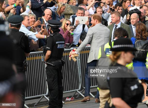 Prince Harry embarks on a walkabout ahead of the royal wedding of Prince Harry and Meghan Markle on May 18 2018 in Windsor England