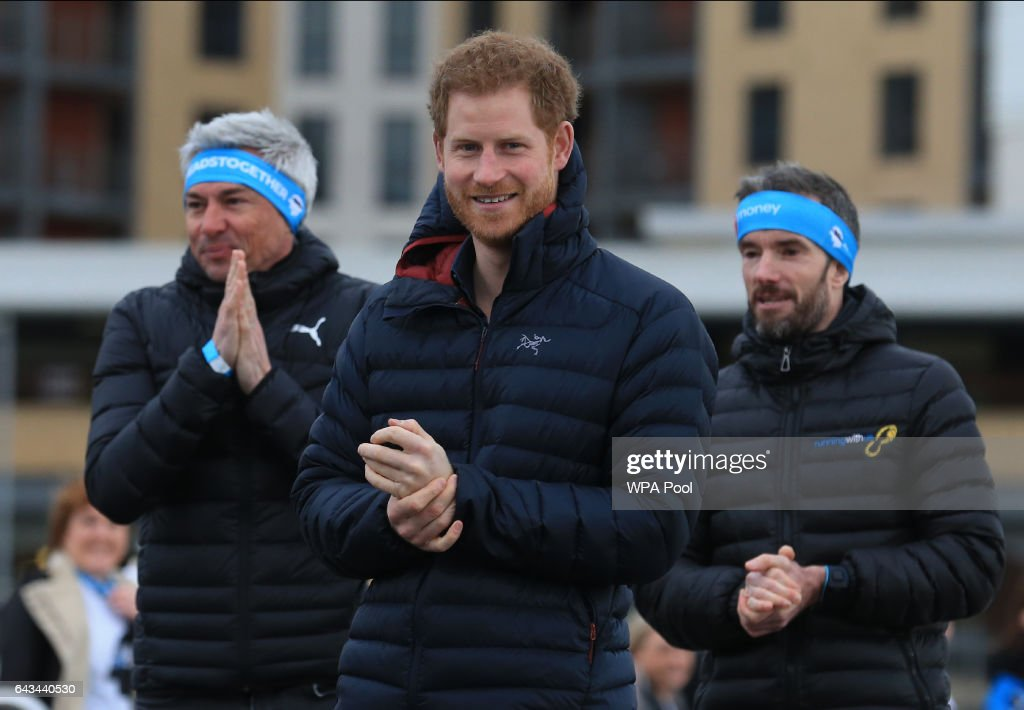Prince Harry (C), English former triple-jumper Jonathan Edwards (L) and a coach (R) attend a training session for runners taking part in the 2017 Virgin Money London Marathon for Heads Together, the official Charity of the Year on February 21, 2017 in Newcastle, United Kingdom.