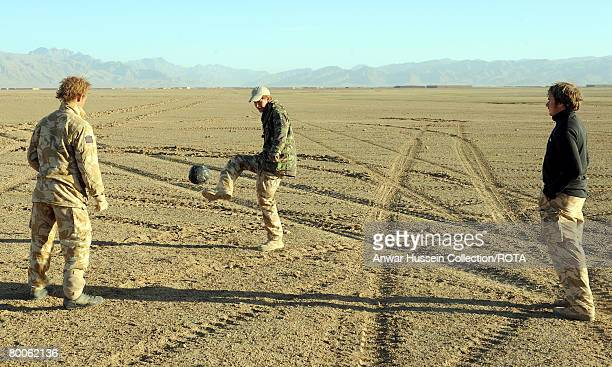 Prince Harry enjoys an early morning kick-about in the desert on February 18, 2008 in Helmand Province, Afghanistan.