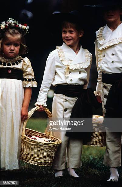 Prince Harry enjoys his role as a pageboy alongside his cousins Eleanor and Alexander Fellowes at the wedding of his uncle Viscount Althorp to...