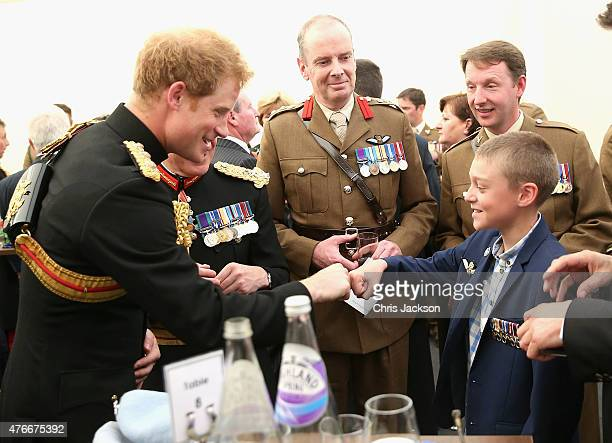 Prince Harry fist bumps Jack Faulkner as he meets familes of those who lost their lives in Afghanistan after the unveiling of the Bastion Memorial at...