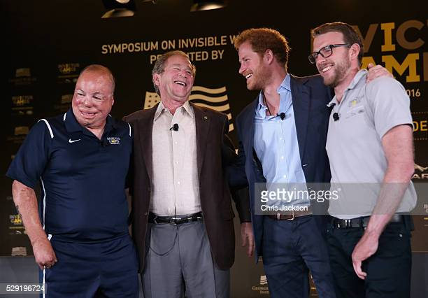 Prince Harry Former President George W Bush Royal Marine veteran JJ Chalmers and Air Force Technical Sgt Israel Del Toro talk at a Symposium of...