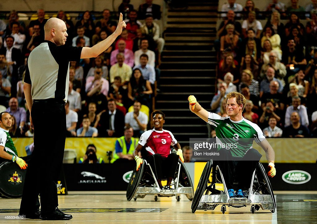 Prince Harry gestures at a referee after being sinbinned during Day Two of the Invictus Games at Olympic Park on September 12, 2014 in London, England.