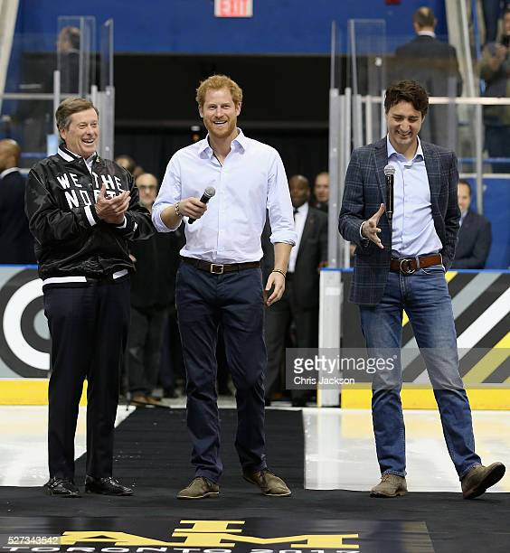 Prince Harry gives a speech as Canadian Prime Minister Justin Trudeau and Toronto Mayor John Tory look on ahead of a sledgehockey match Mattany at...
