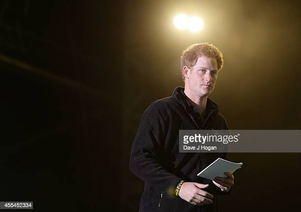 Prince Harry gives a speech at The Jaguar Land Rover Invictus Games Closing Concert at Olympic Park on September 14 2014 in London England