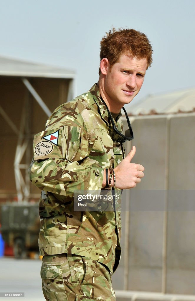 Prince Harry gives a thumbs-up as he examines the Apache flight-line at Camp Bastion on September 7, 2012 in Helmand Province, Afghanistan. Prince Harry has been redeployed to the region to pilot attack helicopters.