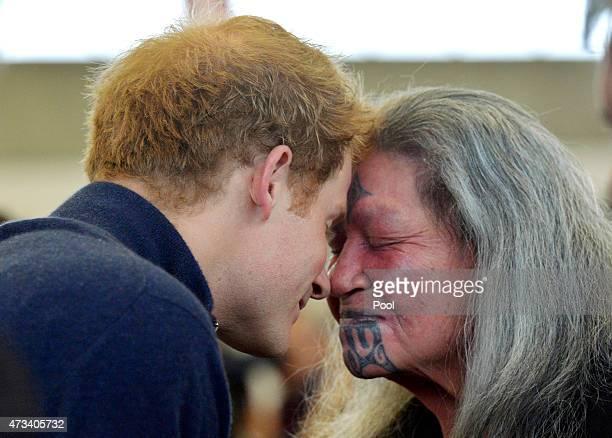 Prince Harry gives Dame Nganeko a Hongi welcome as he visits the Auckland Spinal Rehabiltation Unit on May 15 2015 in Auckland New Zealand Prince...