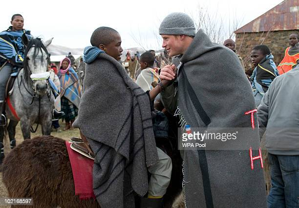 Prince Harry greets a herd boy as he visits the Herd Boys School on June 16 2010 in Semongkong in Lesotho The two Princes are on a joint trip to...