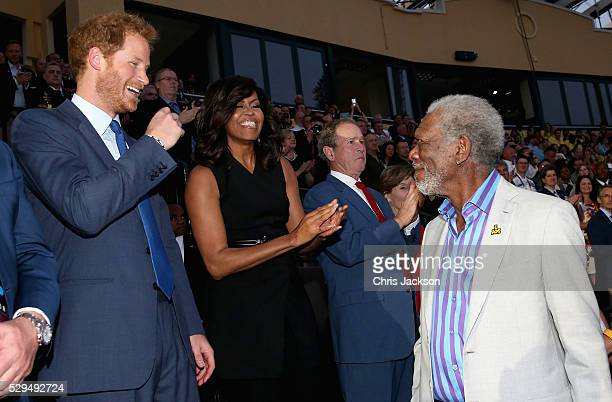 Prince Harry greets actor Morgan Freeman with Michelle Obama and George W Bush in the background during the Opening Ceremony of the Invictus Games...