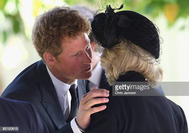 Prince Harry greets Camilla Duchess of Cornwall as they attend a thanksgiving service for Prince Harry's godfather Gerald Ward at St Mary's Church...