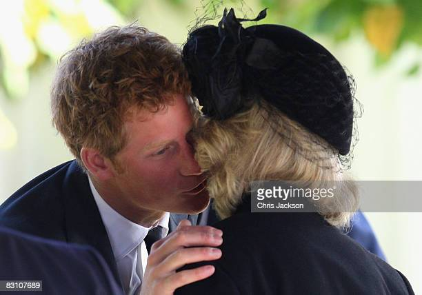Prince Harry greets Camilla Duchess of Cornwall as they attend a thanksgiving service for Gerald Ward godfather of Prince Harry at St Mary's Church...