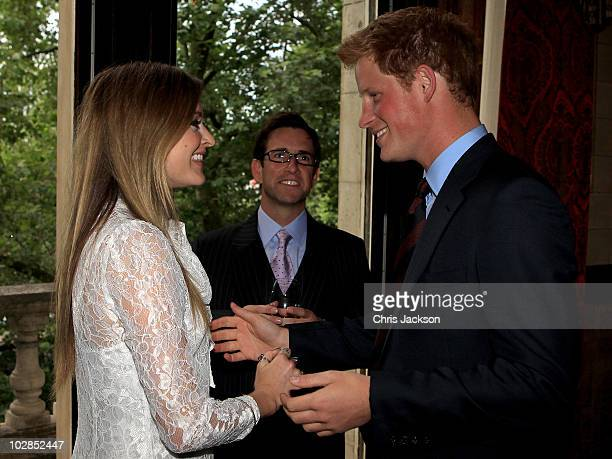 Prince Harry greets Fearne Cotton as he attends the Friends of the Forces Awards at the Liberal Club on July 13 2010 in London England The Prince...