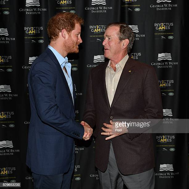 Prince Harry greets George W. Bush during the Opening Ceremony of the Invictus Games Orlando 2016 at ESPN Wide World of Sports on May 8, 2016 in...