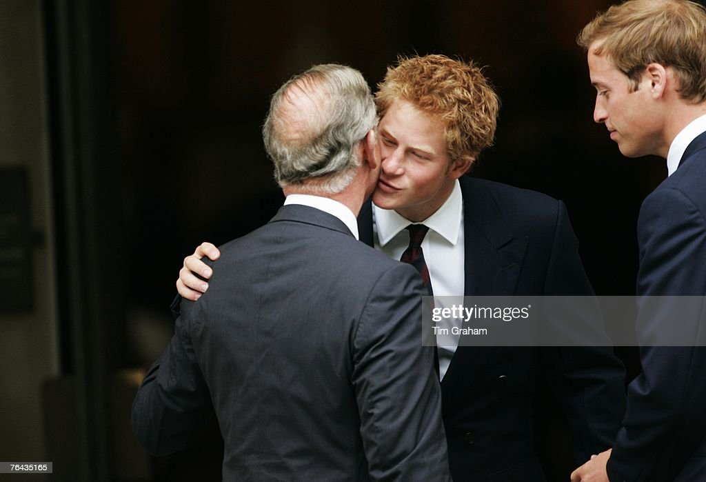 Prince Harry greets his father Prince Charles, Prince of Wales at the 10th Anniversary Memorial Service For Diana, Princess of Wales at Guards Chapel at Wellington Barracks on August 31, 2007 in London, England.