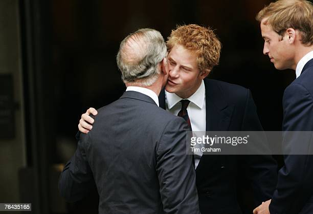 Prince Harry greets his father Prince Charles, Prince of Wales at the 10th Anniversary Memorial Service For Diana, Princess of Wales at Guards Chapel...