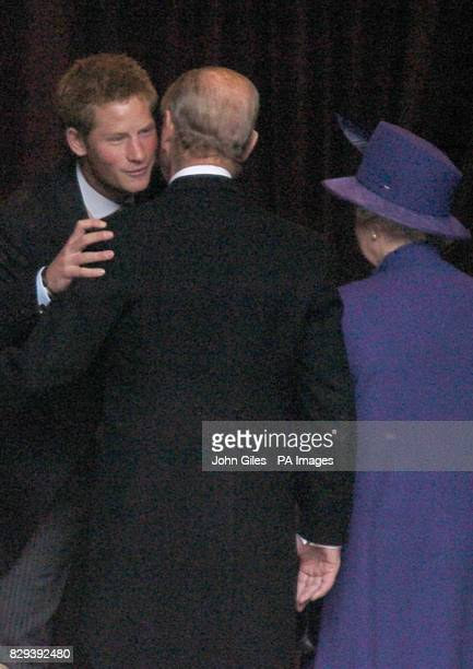 Prince Harry greets his grandparents the Queen and the Duke of Edinburgh at the wedding of Lady Tamara Grosvenor to Edward van Cutsem at Chester...