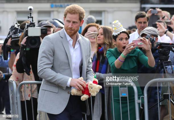 Prince Harry greets members of the public as he embarks on a walkabout ahead of the royal wedding of Prince Harry and Meghan Markle on May 18 2018 in...