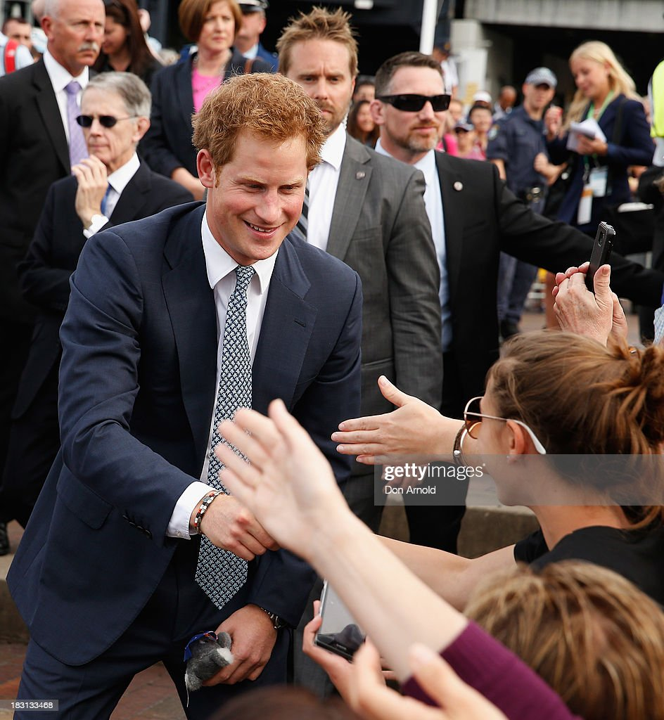 Prince Harry greets members of the public at Campbell Cove on October 5, 2013 in Sydney, Australia. Over 50 ships participate in the International Fleet Review at Sydney Harbour to commemorate the 100 year anniversary of the Royal Australian Navy's fleet arriving into Sydney. Prince Harry is an official guest of the Australian Government and will take part in the fleet review during his two-day visit to Australia.