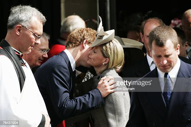 Prince Harry greets Sophie Countess of Wessex and Peter Phillips as they leave the 10th Anniversary Memorial Service For Diana Princess of Wales at...