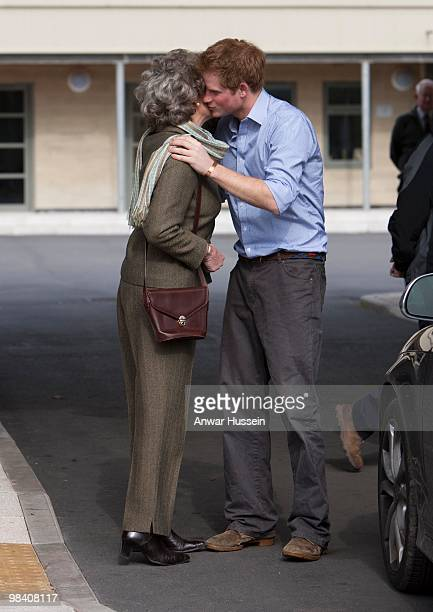 Prince Harry greets Tiggy LeggeBourke's mother Shan Lord Lieutenant of Powys with a kiss as he arrives to meet army cadets training in the Black...
