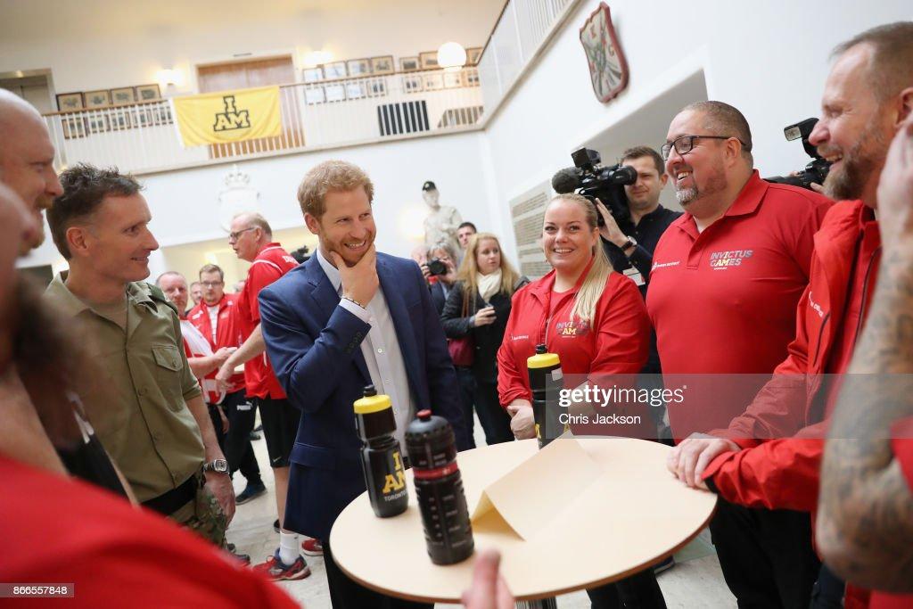 Prince Harry (C) greets veterans following a Rolling Floorball match, a sport invented by Danish veterans, at the Danish Veteran Centre on October 26, 2017 in Copenhagen, Denmark.