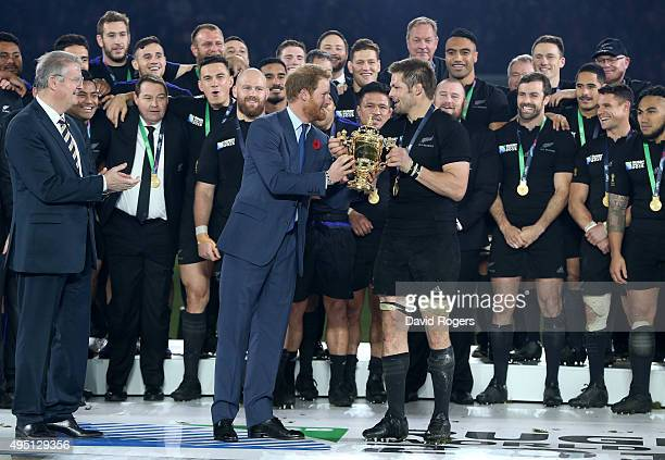 Prince Harry hands the Webb Ellis Cup to victorious captain Richie McCaw of New Zealand during the 2015 Rugby World Cup Final match between New...