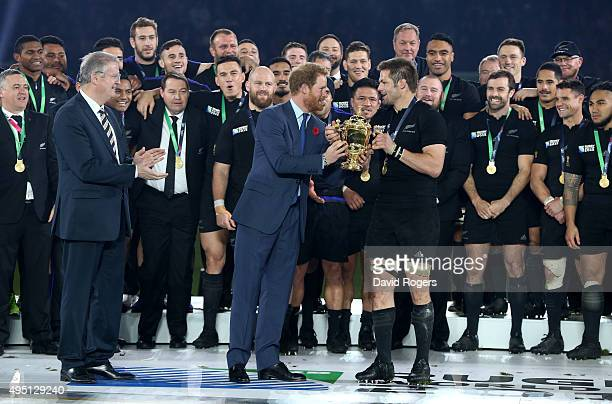 Prince Harry hands the Webb Ellis Cup to winning captain Richie McCaw of New Zealand during the 2015 Rugby World Cup Final match between New Zealand...