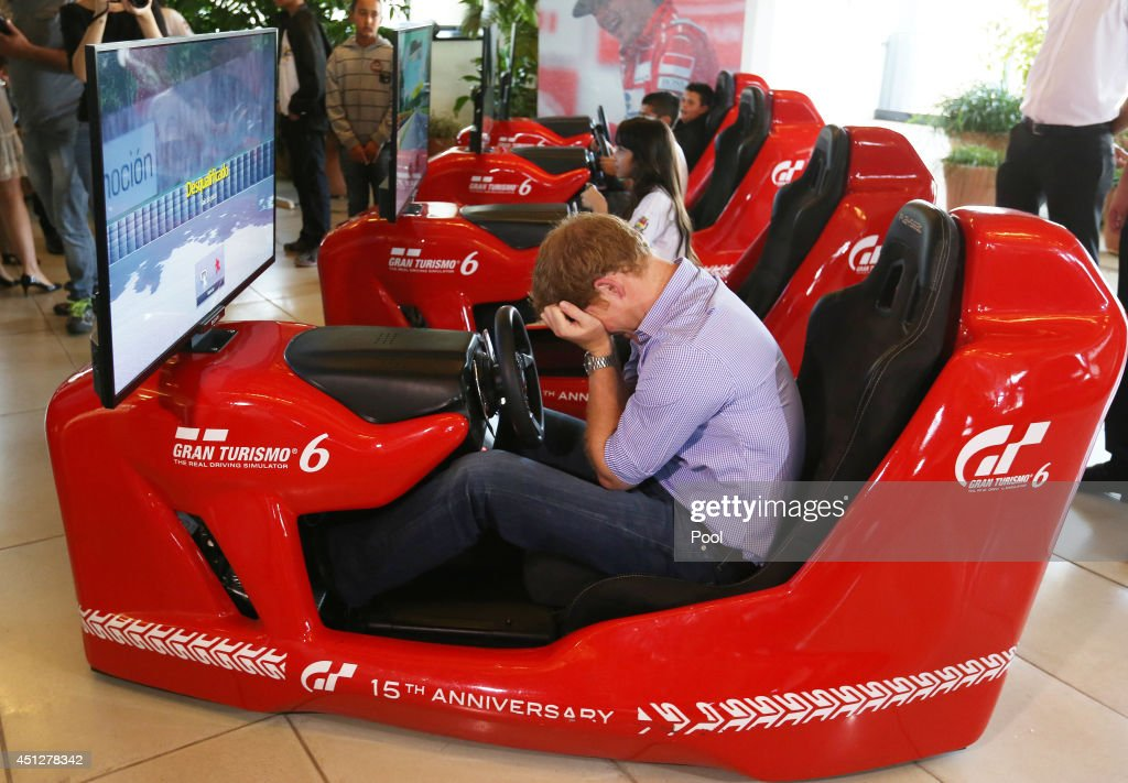 Prince Harry has a go on a Formula 1 driving simulator at the Ayrton Senna Institue on June 26, 2014 in Sao Paulo Brazil. Prince Harry is on a four day tour of Brazil that will be followed by two days in Chile.