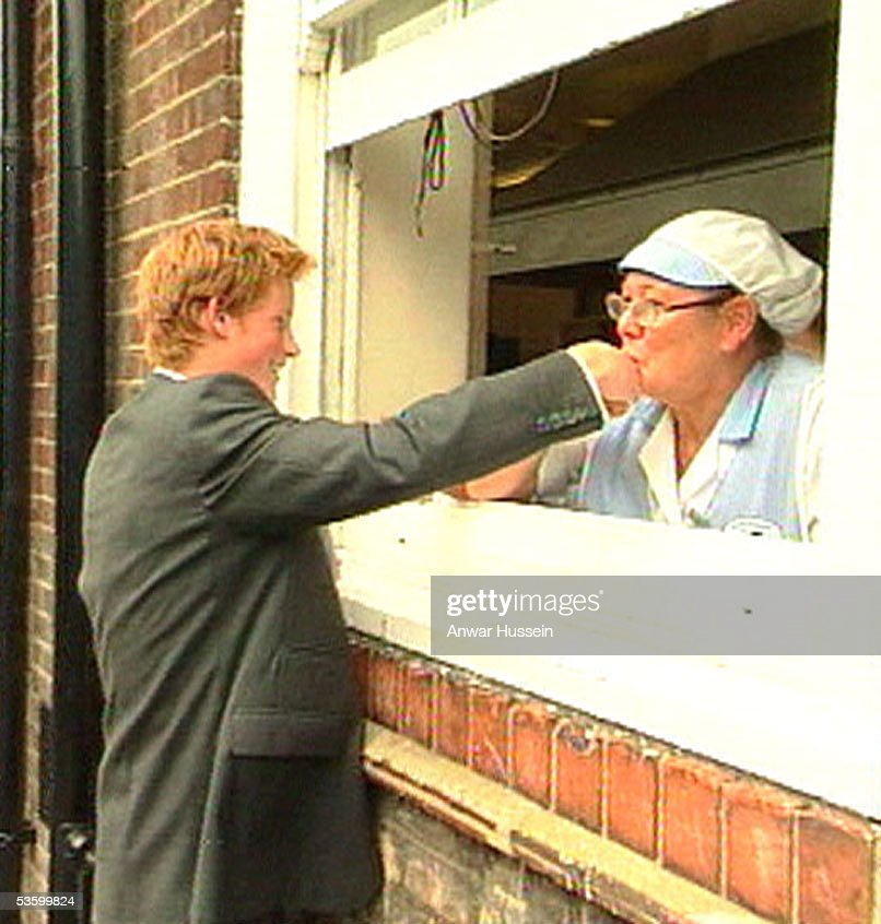 Prince Harry has his hand kissed by a dinner lady during a visit to the Osmani School, where pupils learn about health issues facing people in the third world, on September 12, 2002 in London, England. He was spending the day visiting charities and causes which he intends to support