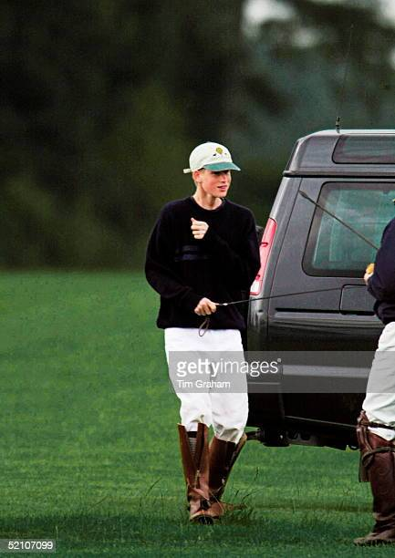 Prince Harry Holding A Horse Whip At The Beaufort Polo Clubhe Was There To Watch His Father Play In A Charity Match In The Calcot Manor Cup