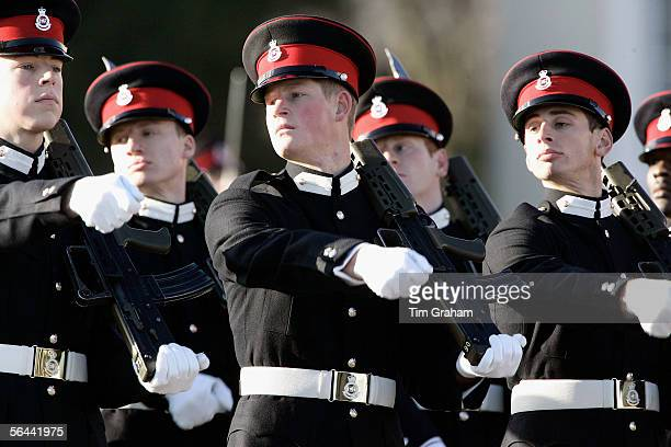 Prince Harry holds an army issue SA80 riffle during a Passing Out Parade at Sandhurst Military Academy on December 16 2005 in Surrey England