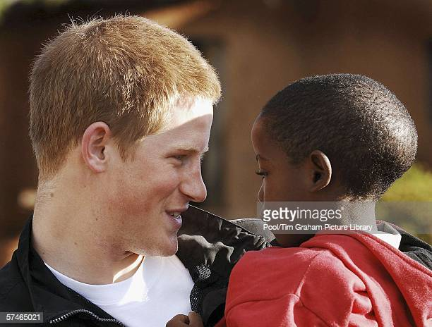 Prince Harry holds his old friend Mutsu Potsane in the grounds of the Mants'ase children's home while on a return visit to Lesotho in southern Africa...