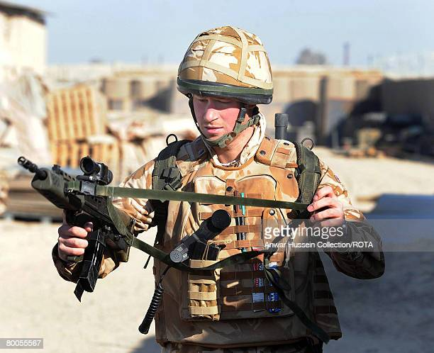 Prince Harry holds his SA80 rifle while on patrol through the deserted town of Garmisir on January 2, 2008 in Helmand Province, Afghanistan.