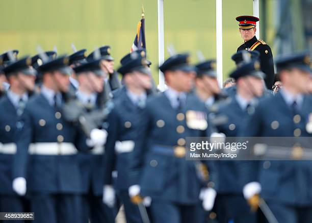 Prince Harry Honorary Air Commandant presents No 26 Squadron RAF Regiment with a new Standard during a parade at RAF Honington on November 13 2014 in...