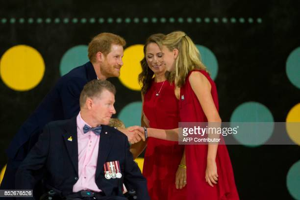 Prince Harry honours Retired Captain Trevor Greene of the Canadian Armed Forces during the opening ceremonies of the Invictus Games in Toronto...