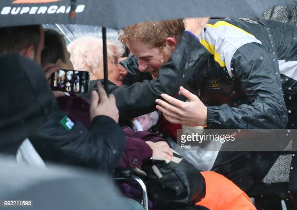 Prince Harry hugs 97yearold Daphne Dunne who he had met on an earlier visit to Sydney during an event where he met members of the public in the...