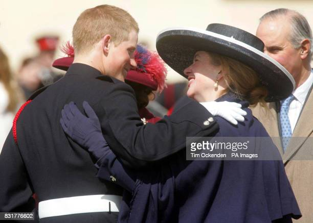 Prince Harry hugs his former nanny Tiggy Pettifer after The Sovereign's Parade at the Royal Military Academy at Sandhurst in Surrey to mark the...