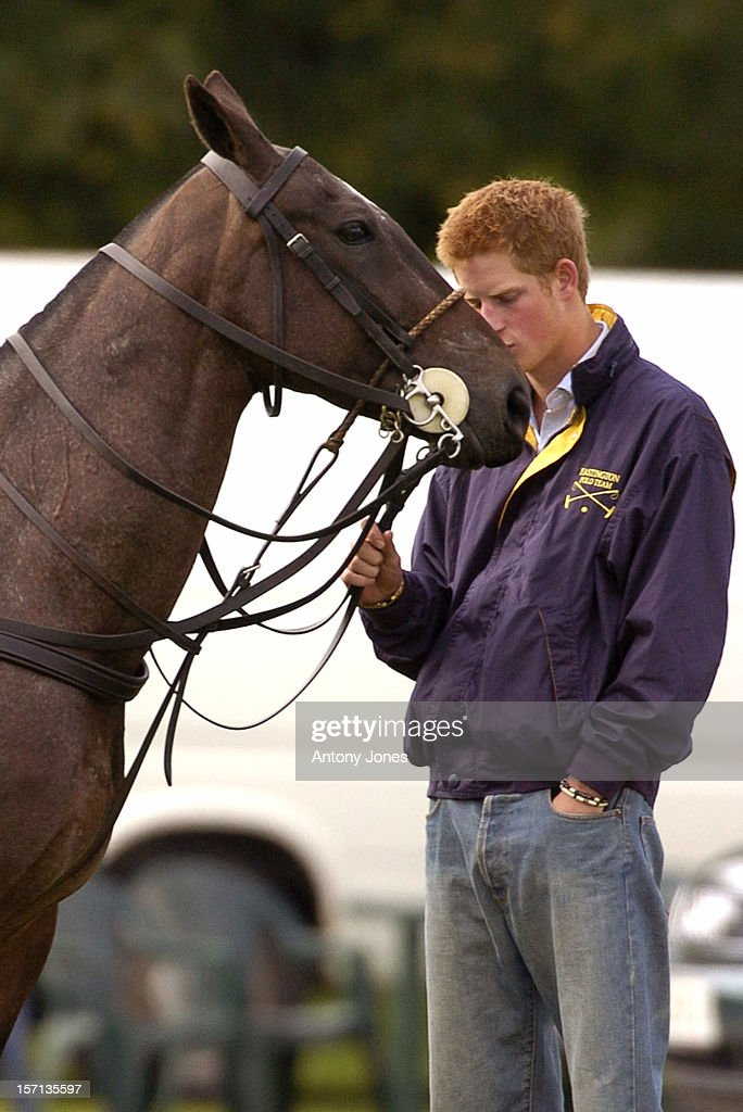 Prince Harry Hugs & Kisses A Horse At A Match At The Cirencester Park Polo Club.