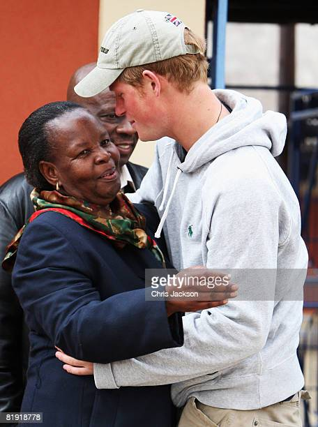Prince Harry hugs Ma Motsephe as he arrives at LCCU on July 9, 2008 in Maseru, Lesotho. Prince Harry and 26 soldiers from the Household Cavalry are...