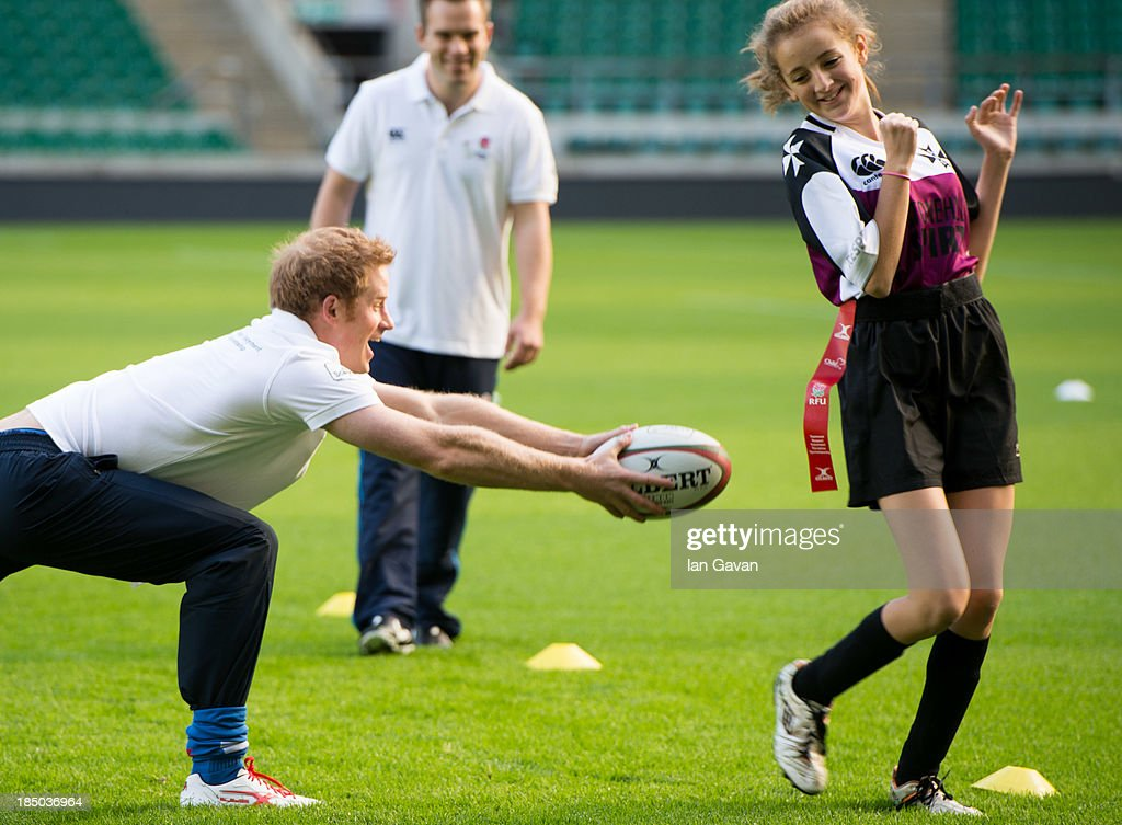 Prince Harry in action during his visit to the RFU All School programme coaching event at Twickenham Stadium on October 17, 2013 in London, England.