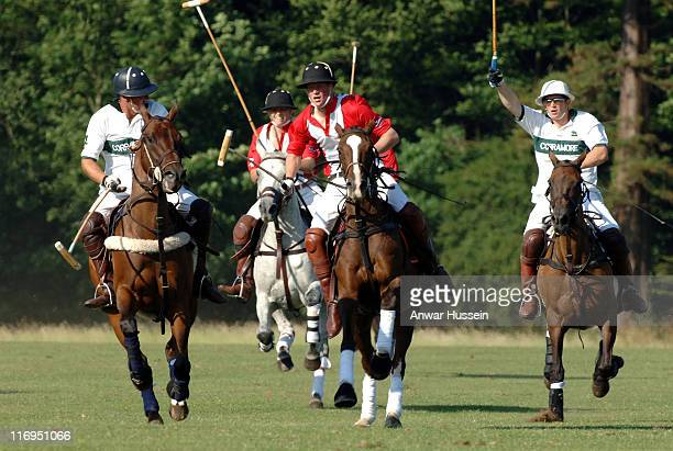 Prince Harry in action during the Queen Mother Trophy at Cirencester Park Polo Club on July 17 2005 in Cirencester England