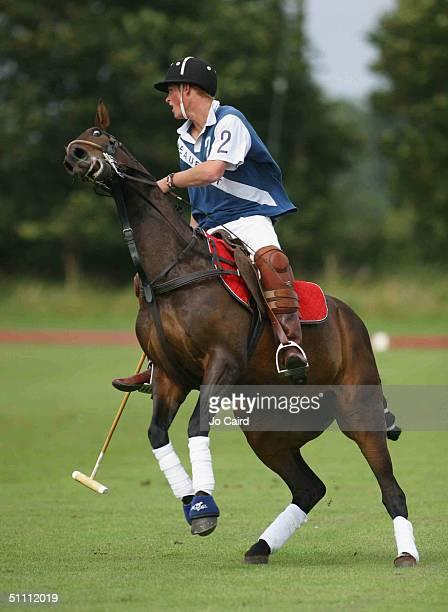 Prince Harry in action during the The Ronnie Wallace Memorial match at Beaufort Polo Club in Westonbirt on July 24 2004 in Gloucestershire England
