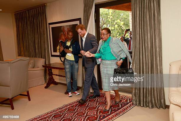 Prince Harry in Nelson Mandela's office with Graca Machel his widow at the Nelson Mandela Foundation Centre of Memory on December 3 2015 in...
