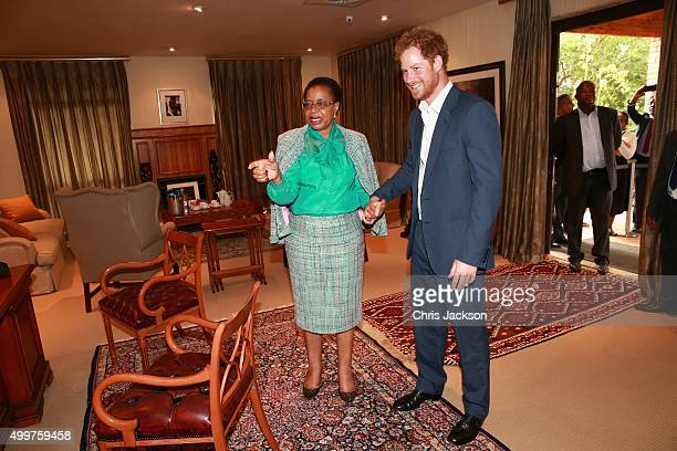 Prince Harry in Nelson Mandela's office with his widow Graca Machel at the Nelson Mandela Foundation Centre of Memory on December 3 2015 in...