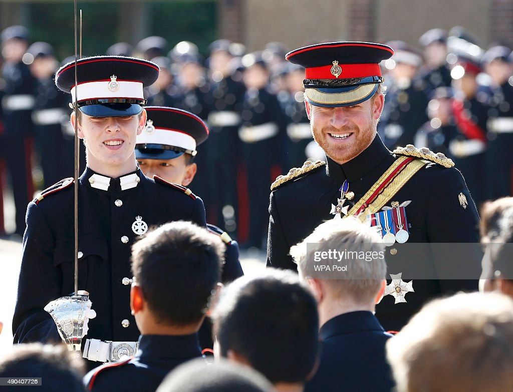 Prince Harry inspects the student guards during his visit to The Duke of York's Royal Military School on September 28, 2015 in Dover, England.